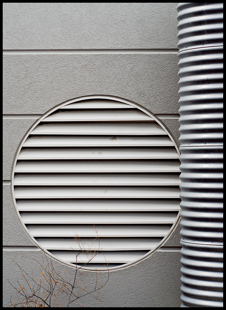 Abstract photograph of industrial building emphasizing circles and lines