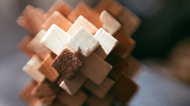 Abstract photograph of wooden match sticks with contrasting light and shadow