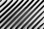 Abstract image of snow on city street grate