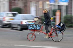 pan motion photograph of Amsterdam woman on uniqu bike by FaceMePLS https://flic.kr/p/9fE5Gj