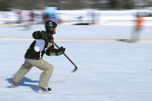 pan motion photograph of skater playing pond hockey by Jamie McCaffrey https://flic.kr/p/jTxCLs