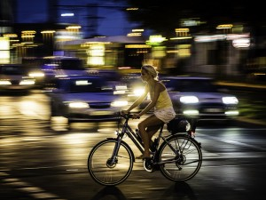 "pan motion photography of ""Woman on Bike in front of Cars"" by Sascha Kohlmann https://flic.kr/p/orvq8H"