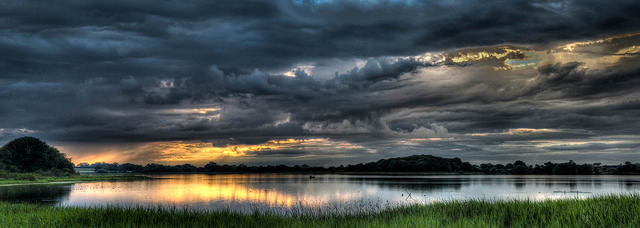 landscape photograph of lake with dramatic cloud cover by by Mark Freeth https://flic.kr/p/oa6jdY